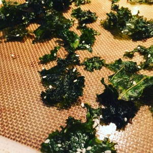 Quick and easy kale chips, baked with sesame seeds.
